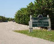 Barefoot beach sign