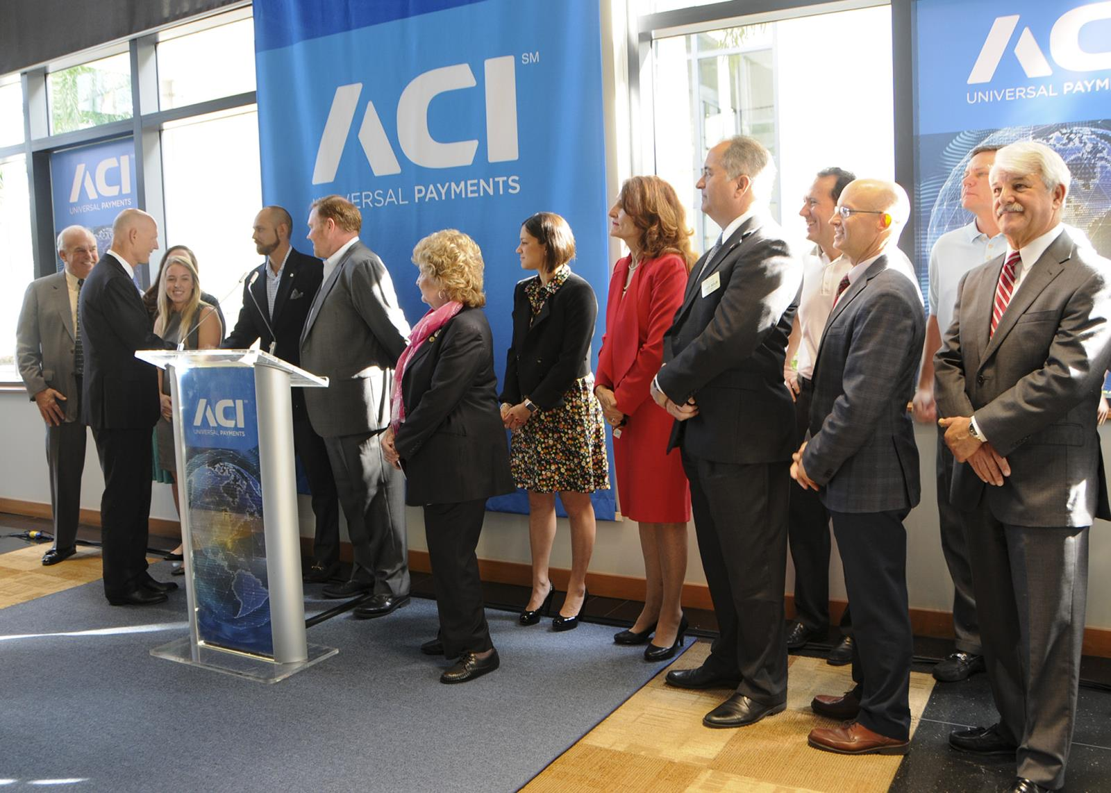 Governor Scott greeting people at ACI Universal Payments ceremony