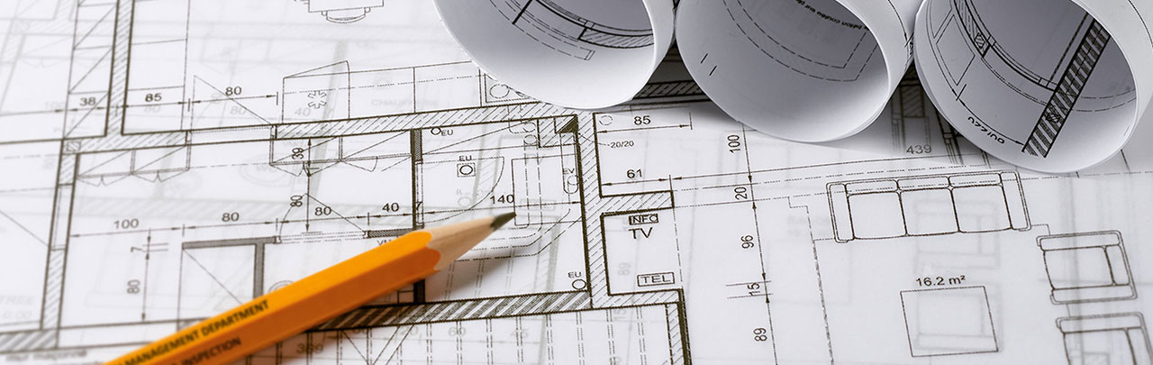 building plans laid out on a work surface