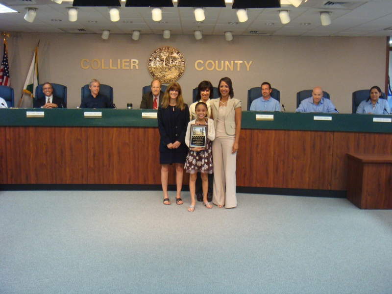 Estates Elementary School representative receiving award for naming preserve